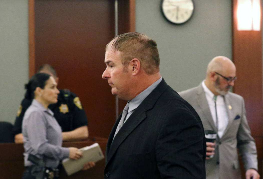 A former Las Vegas fire Capt. Richard Loughry, 48, leaves the courtroom at the Regional Justice Center on Monday, March 4, 2019, in Las Vegas. Loughry pleaded guilty to two felonies after authorit ...