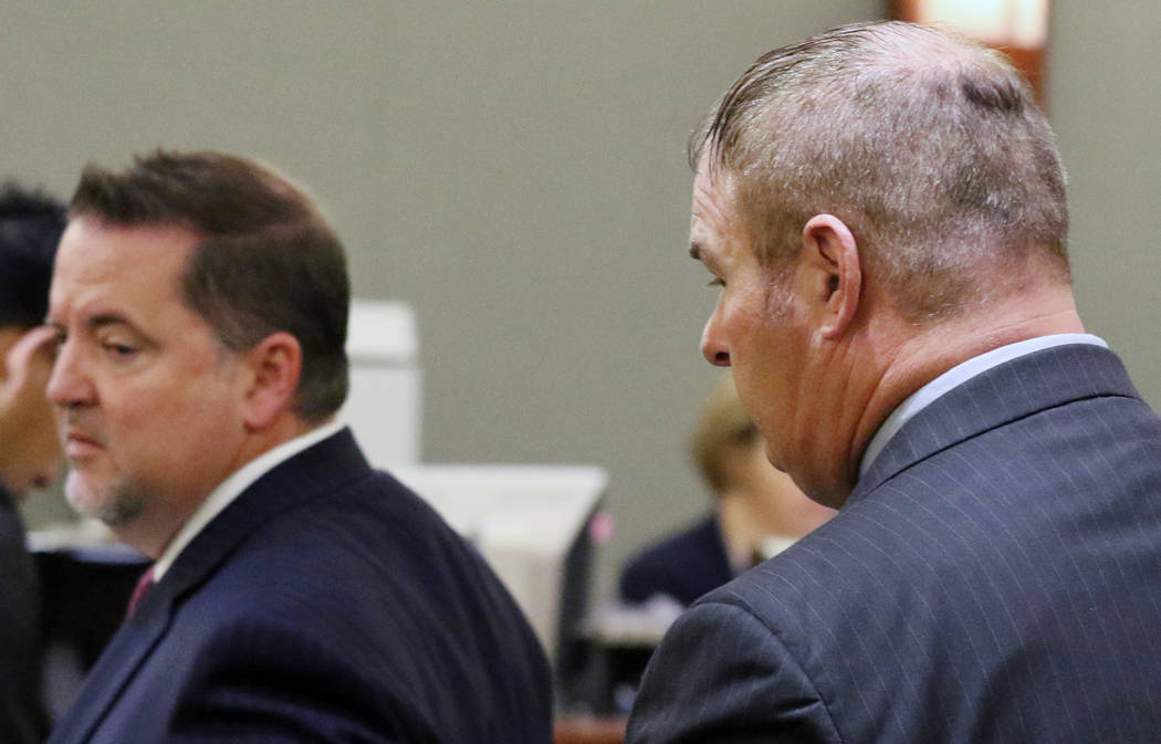 A former Las Vegas Fire Capt. Richard Loughry, 48, right, and his attorney Craig Hendricks leave the courtroom at the Regional Justice Center on Monday, March 4, 2019, in Las Vegas. Loughry plead ...