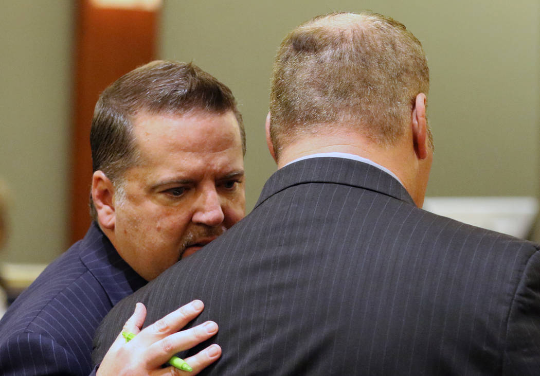 A former Las Vegas Fire Capt. Richard Loughry, 48, right, listens to his attorney Craig Hendricks at the Regional Justice Center on Monday, March 4, 2019, in Las Vegas. Loughry pleaded guilty to ...