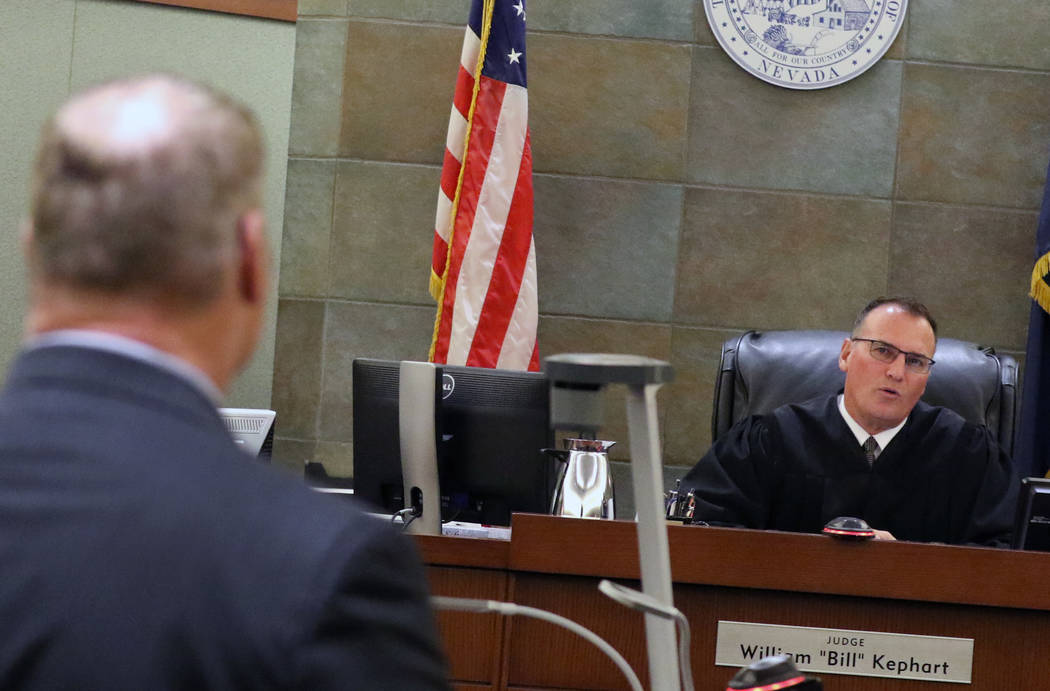 A former Las Vegas Fire Capt. Richard Loughry, 48, listens to District Judge William Kephart at the Regional Justice Center on Monday, March 4, 2019, in Las Vegas. Loughry pleaded guilty to two f ...