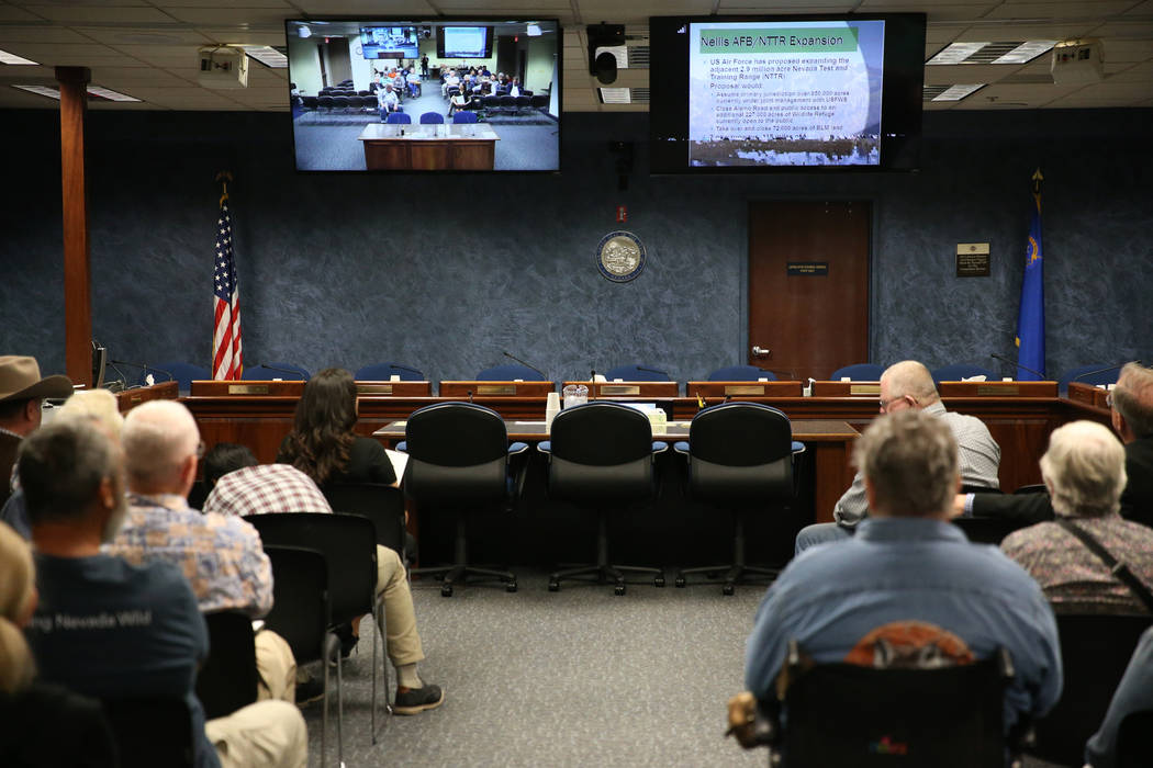 People watch a televised Senate Committee on Natural Resources meeting on a joint resolution opposing plans to expand an Air Force bombing range in Southern Nevada, at the Grant Sawyer State Offic ...