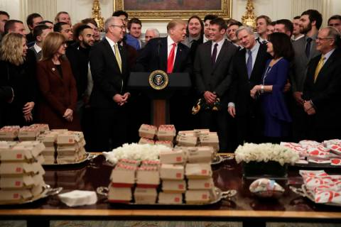 President Donald Trump welcomes the 2018 NCAA FCS College Football Champions, The North Dakota State Bison, to the State Dining room of the White House in Washington, Monday, March 4, 2019, with M ...