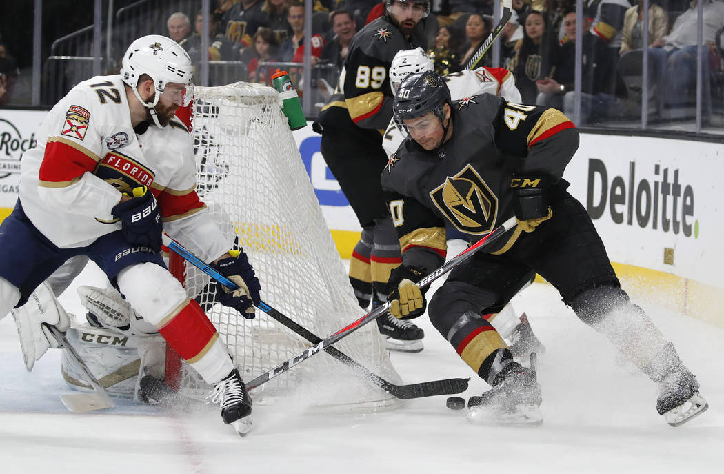 Florida Panthers defenseman Ian McCoshen (12) knocks the puck away from Vegas Golden Knights center Ryan Carpenter (40) during the second period of an NHL hockey game Thursday, Feb. 28, 2019, in L ...