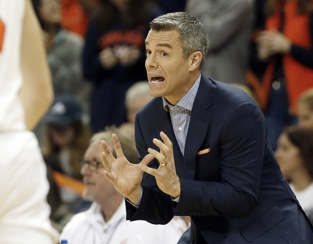 Virginia head coach Tony Bennett directs his team during the first half of an NCAA college basketball game against Pittsburgh in Charlottesville, Va., Saturday, March 2, 2019. (AP Photo/Steve Helber)