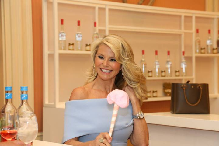 Christie Brinkley uses a little cotton candy as a prop at the Wine & Spirits Wholesalers of America's (WSWA) 75th Annual Convention and Exposition at Caesars Palace on Wednesday, May 2, 2018. (S ...
