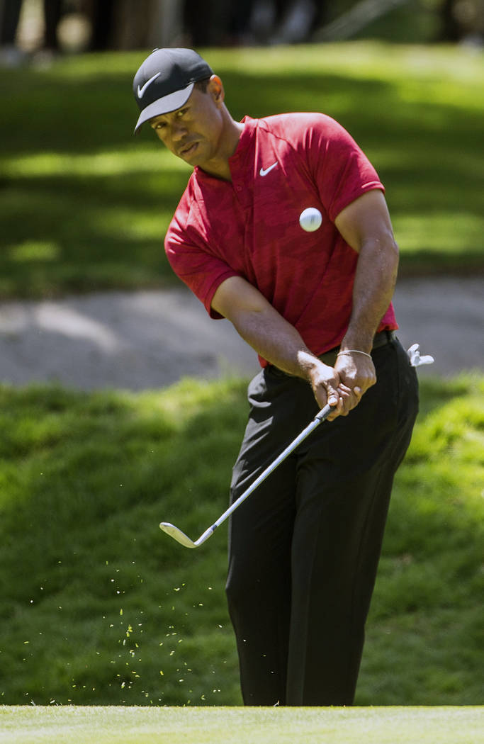 FILE - In this Feb. 24, 2019, file photo, Tiger Woods hits the ball on the first hole during the WGC-Mexico Championship at the Chapultepec Golf Club in Mexico City. Woods has withdrawn from the A ...