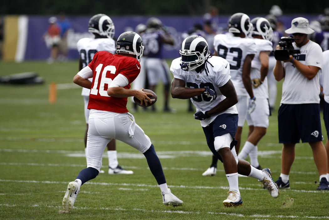 Los Angeles Rams running back Todd Gurley, right, runs a drill with quarterback Jared Goff during a joint NFL football training camp practice at the Baltimore Raven's headquarters, Tuesday, Aug. 7 ...