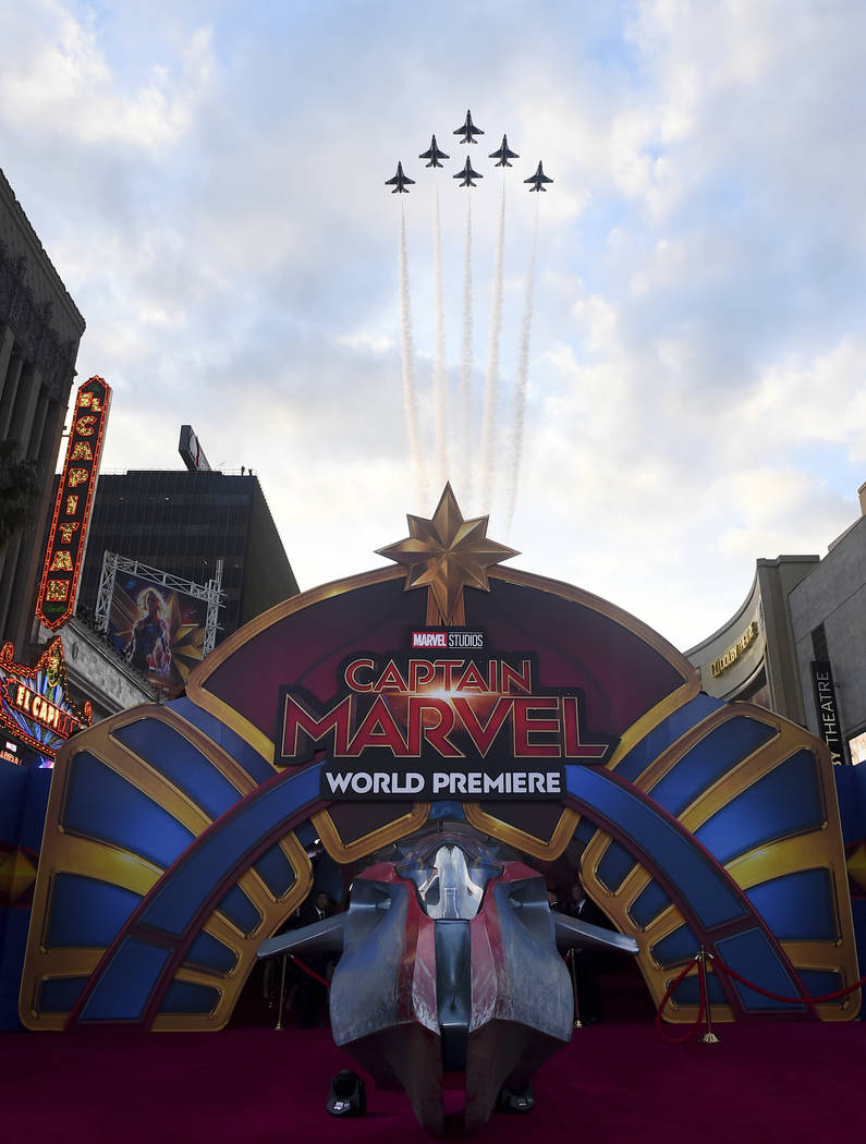 """The U.S. Air Force Thunderbirds fly over the world premiere of """"Captain Marvel"""" on Monday, March 4, 2019, at the El Capitan Theatre in Los Angeles. (Jordan Strauss/Invision/AP)"""