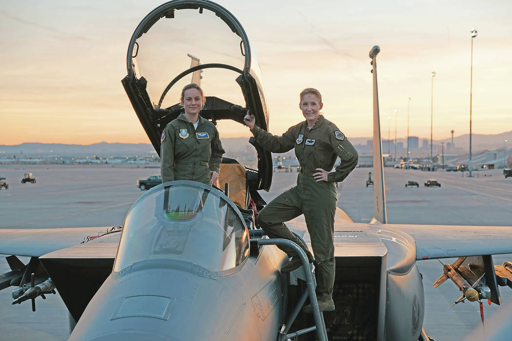 Marvel Studios' CAPTAIN MARVEL..Brie Larson (left) gets hands-on help from Brigadier General Jeannie Leavitt, 57th Wing Commander (right), on a recent trip to Nellis Air Force Base in Nevada to re ...