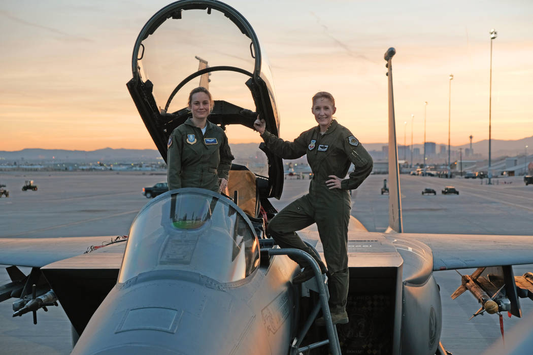 Brie Larson, left, gets hands-on help from Brigadier Gen. Jeannie Leavitt, who was 57th Wing Commander at Nellis Air Force Base, on a recent trip to Nellis in Las Vegas to research her character, ...