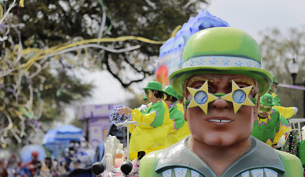The Krewe of Thoth rolls along the Uptown route in New Orleans, La. Sunday, March 3, 2019. Founded in 1947, the Krewe of Thoth is named for the Egyptian Patron of Wisdom and Inventor of Science, A ...