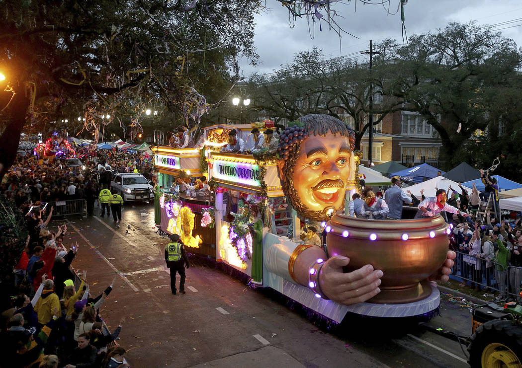 "The Officer's Float rolls down Napoleon Avenue as the 1,600 men of Bacchus present their 32-float Mardi Gras parade entitled ""Starring Louisiana"" on the Uptown route in New Orleans on Su ..."