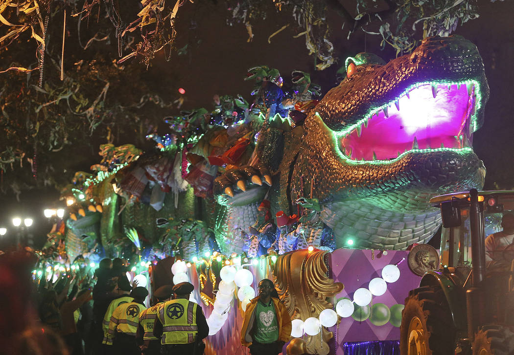 "The Bacchagator rolls down Napoleon Avenue as the 1,600 men of Bacchus present their 32-float Mardi Gras parade entitled ""Starring Louisiana"" on the Uptown route in New Orleans on Sunday ..."