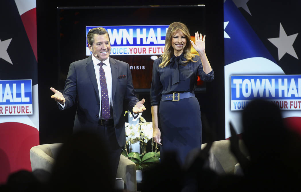 First lady Melania Trump acknowledges the crowd alongside television personality Eric Bolling at a town hall about opioid addiction as part of her Be Best campaign at the Westgate Theater in Las V ...
