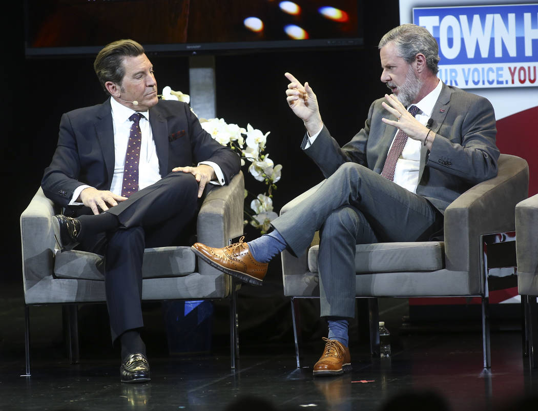 Jerry Falwell Jr., president of Liberty University, right, speaks with television personality Eric Bolling during a town hall about opioid addiction at the Westgate Theater in Las Vegas on Tuesday ...