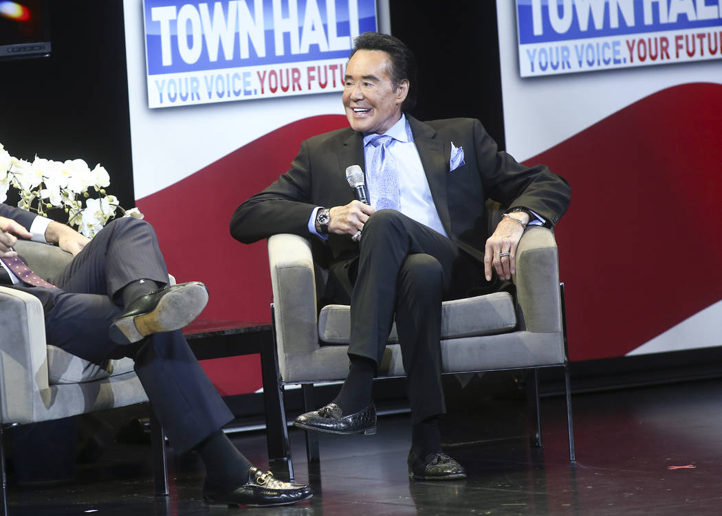 Entertainer Wayne Newton speaks with television personality Eric Bolling during a town hall about opioid addiction at the Westgate Theater in Las Vegas on Tuesday, March 5, 2019. (Chase Stevens/La ...
