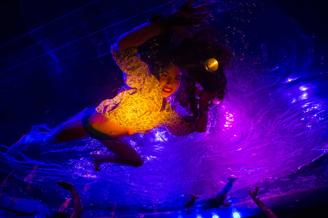"A cast members in ""Fuerza Bruta"" performs on a mylar suspended pool as part of a media preview at the show's tent outside of the Excalibur in Las Vegas on Wednesday, March 6, 2019. The s ..."