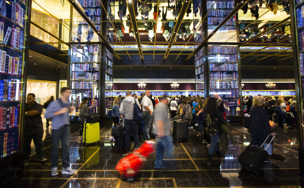 Resort guests wait in line to check-in at the main lobby of The Cosmopolitan of Las Vegas on Thursday, March 7, 2019. (Chase Stevens/Las Vegas Review-Journal) @csstevensphoto