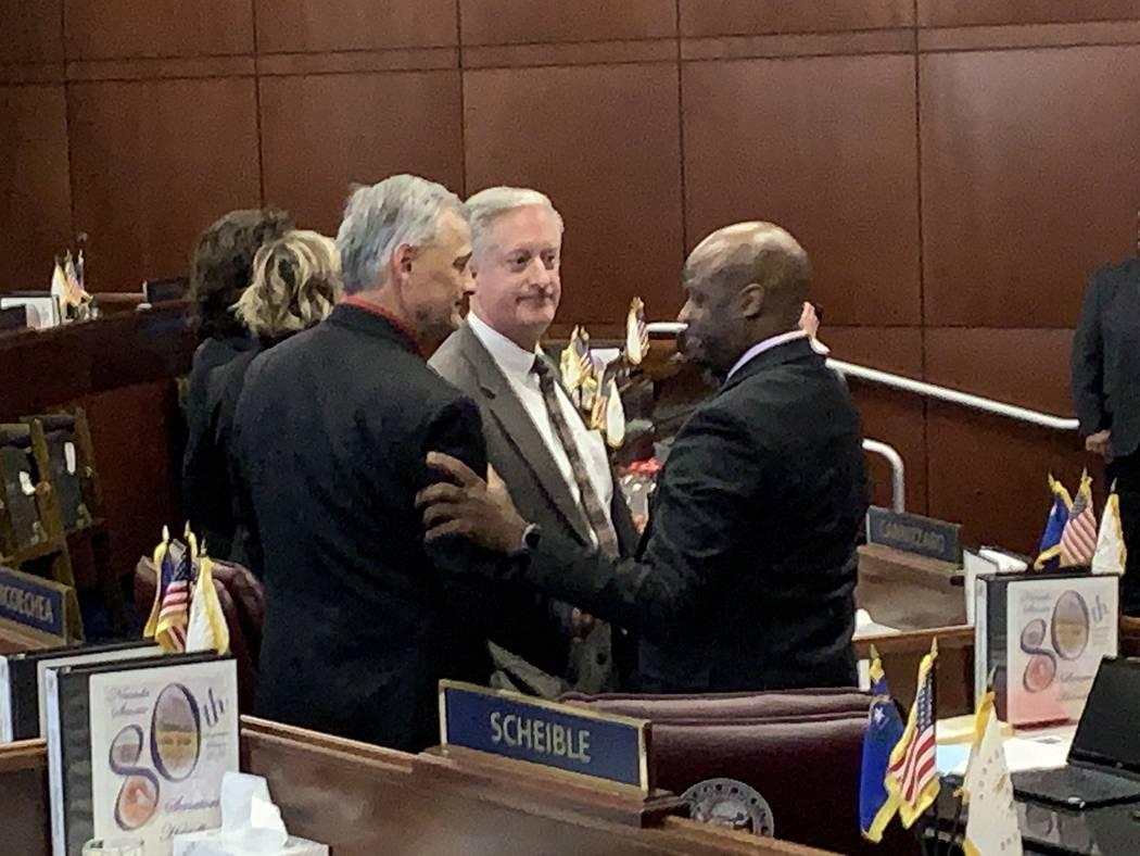 Nevada Senate Majority Leader Kelvin Atkinson, D-Las Vegas, at right, is greeted by GOP Senate Minority Leader James Settelmeyer and GOP Senate