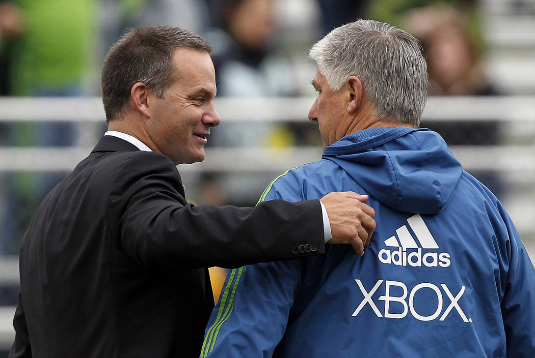 Seattle Sounders head coach Sigi Schmid, right, and Cal FC head coach Eric Wynalda chat before a U.S. Open Cup fourth-round soccer game Tuesday, June 5, 2012, in Tukwila, Wash. (AP Photo/Elaine Th ...