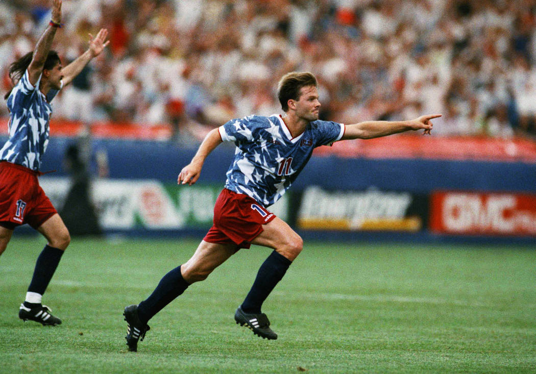 United States national team forward Eric Wynalda, right, reacts after he scored against Switzerland in a World Cup soccer championship Group A first-round match at the Pontiac, Mich., Silverdome o ...