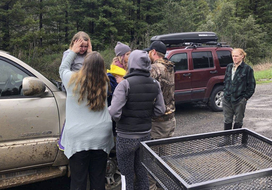 This Sunday, March 3, 2019 photo provided by the Humboldt County Sheriff's Office shows 5- and 8-year-old sisters Leia, left and Caroline Carrico being comforted after they were found and reunited ...