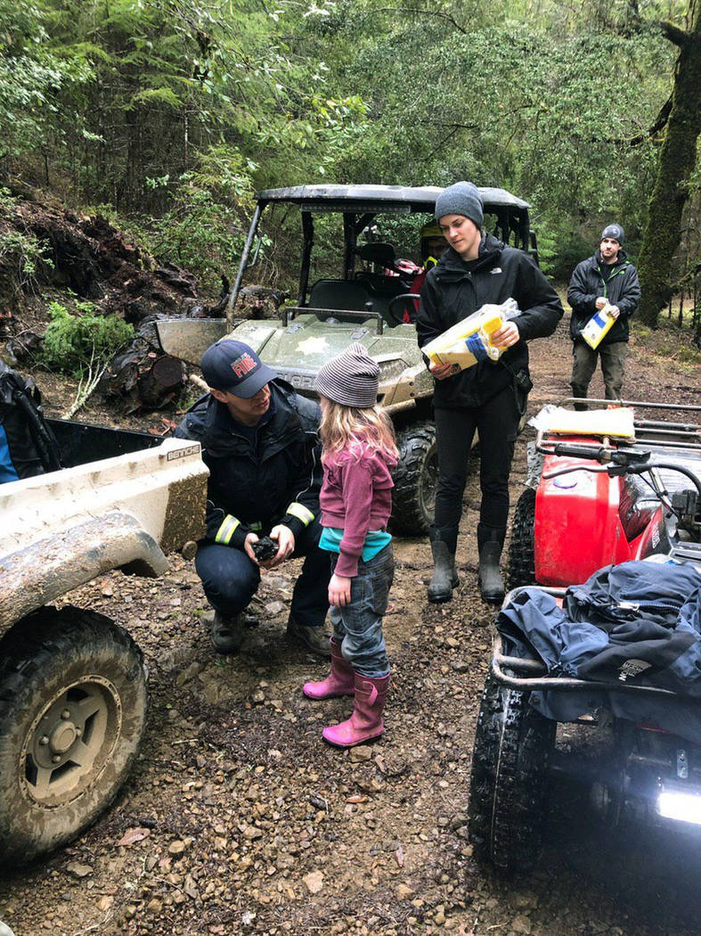 In this Sunday, March 3, 2019 photo provided by the Humboldt County Sheriff's Office, Caroline Carrico is assessed by search crews after being found near Benbow, Calif. Armed with some outdoor sur ...