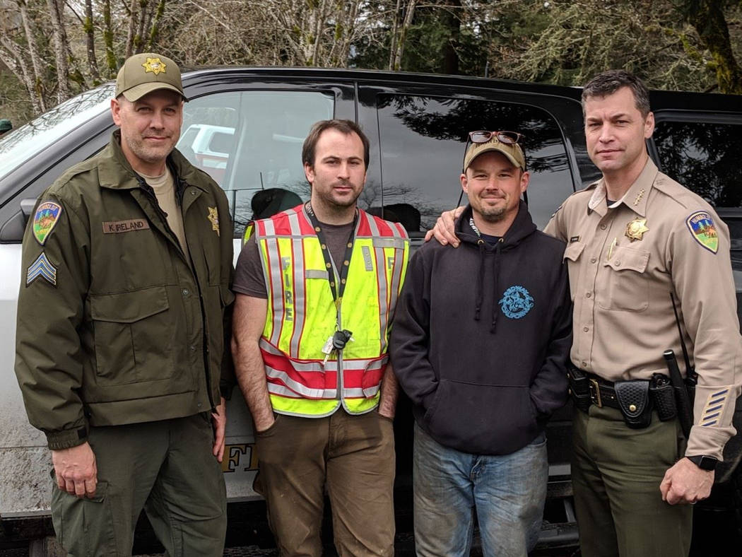 This Sunday, March 3, 2019 photo provided by the Humboldt County Sheriff's Office shows Delbert Chumley, second from right, and Abram Hill, second from left, from Piercy Volunteer Fire Dept. who f ...