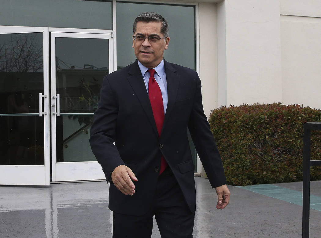 California Attorney General Xavier Becerra leaves leaves the Calvary Christian Center after meeting with SeQuette Clark, Tuesday, March 5, 2019, in Sacramento, Calif. Becerra is expected later tod ...