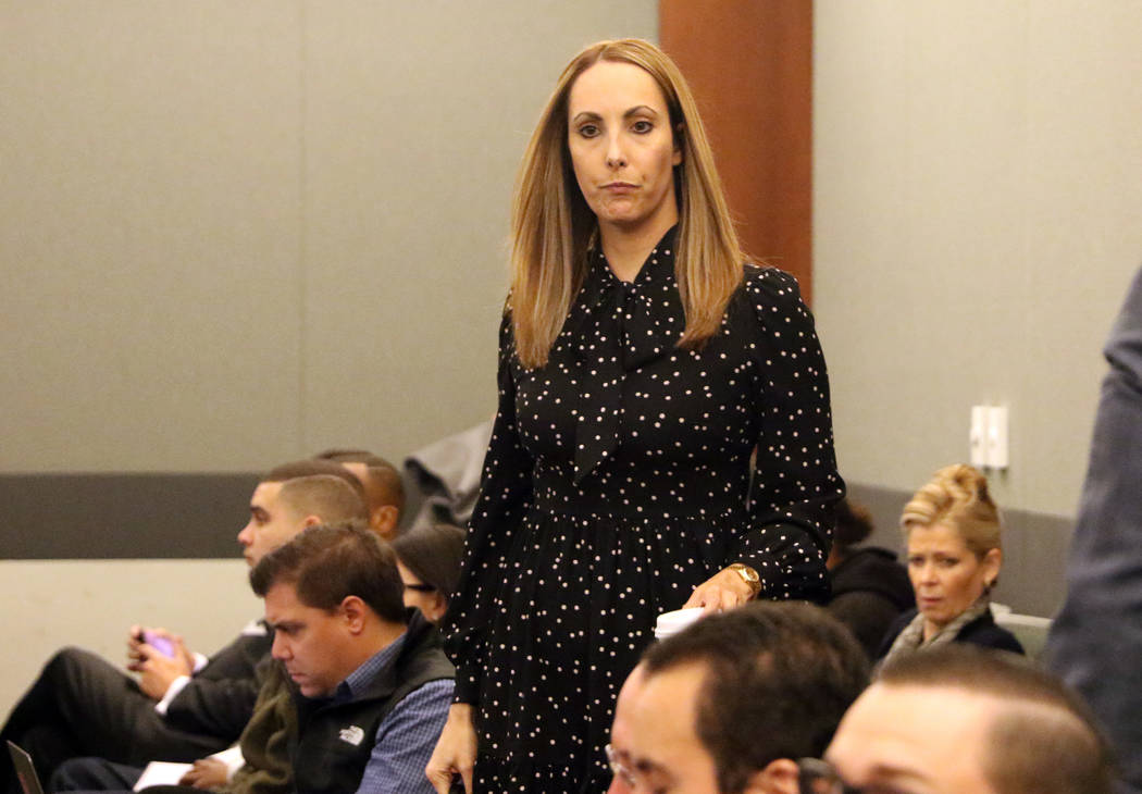 Attorney Alexis Plunkett, who prosecutors say bragged about putting a hit on her former boyfriend in prison, enters the courtroom prior to her hearing on Thursday, Jan. 10, 2019, at the Regional J ...