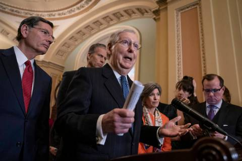 Senate Majority Leader Mitch McConnell, R-Ky., joined from left by Sen. John Barrasso, R-Wyo., Majority Whip John Thune, R-S.D., and Sen. Joni Ernst, R-Iowa, speaks with reporters during a news co ...
