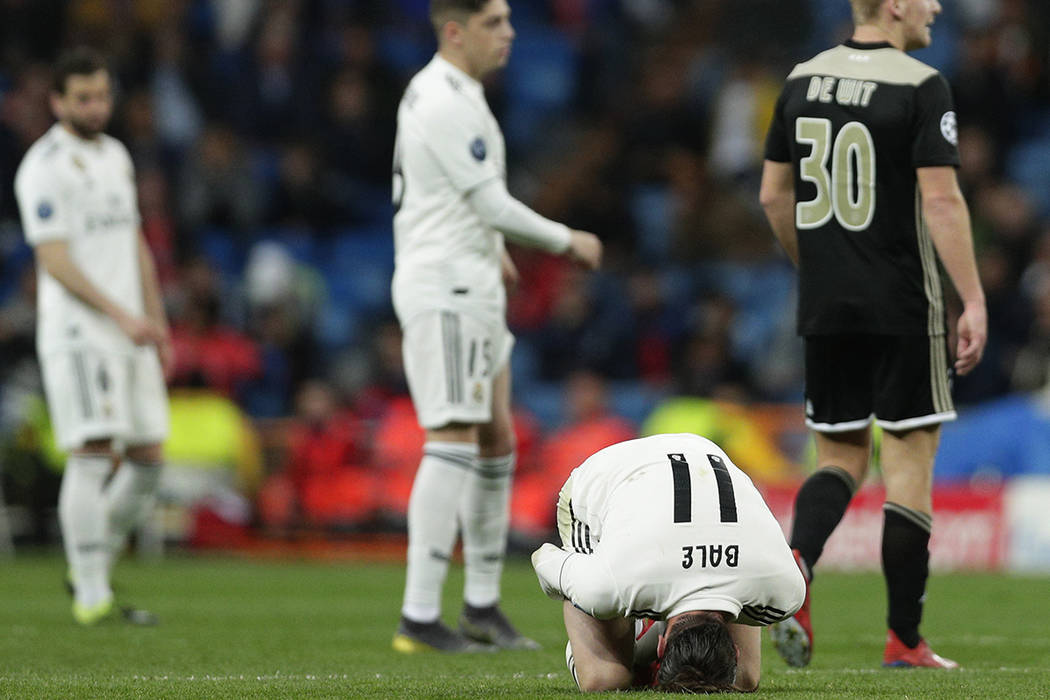 Real midfielder Gareth Bale reacts on the ground during the Champions League soccer match between Real Madrid and Ajax at the Santiago Bernabeu stadium in Madrid, Spain, Tuesday, March 5, 2019. (A ...
