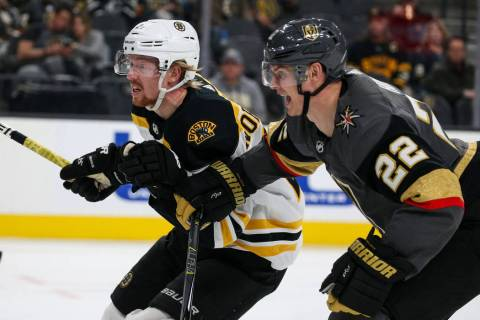 Boston Bruins center Joakim Nordstrom (20) and Vegas Golden Knights defenseman Nick Holden (22) move towards the puck during the second period of an NHL hockey game at T-Mobile Arena in Las Vegas, ...