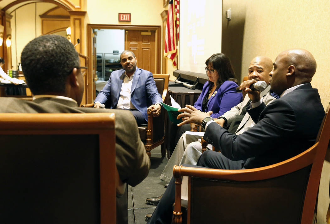 Sen. Kelvin Atkinson, right, speaks during a panel discussion on business and community in honor of Black History Month on Friday, Feb. 23, 2018, in Las Vegas, as Cedric Crear, president of Crear ...