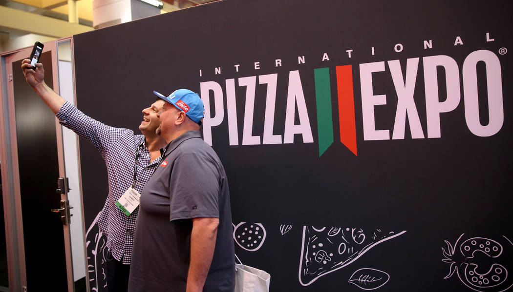 Carlo Luciano of Wayne, Pennsylvania, left, and Lorenzo Colella of Brewster, New York, take a selfie at the International Pizza Expo at the Las Vegas Convention Center Tuesday, March 5, 2019. (K.M ...