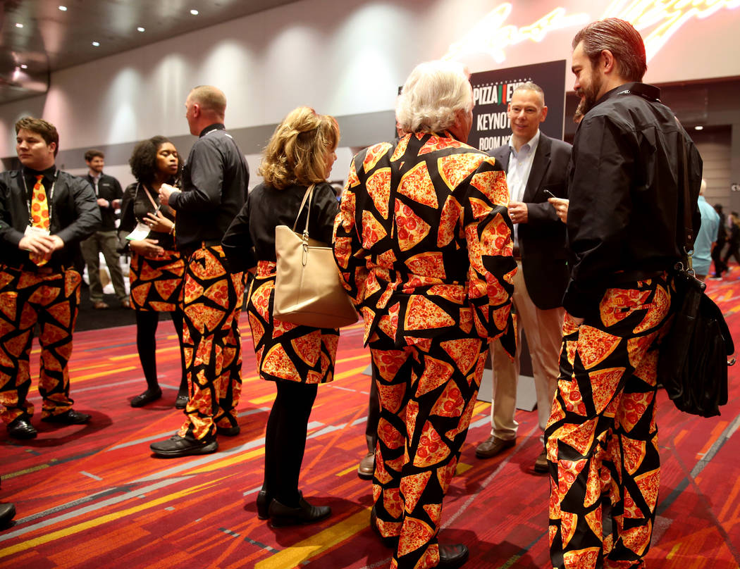 Pat Spaulding of Spaulding & Associates, Inc., of Brighton Michigan, in suit, talks to his Cheese Guys team at the International Pizza Expo at the Las Vegas Convention Center Tuesday, March 5, 201 ...