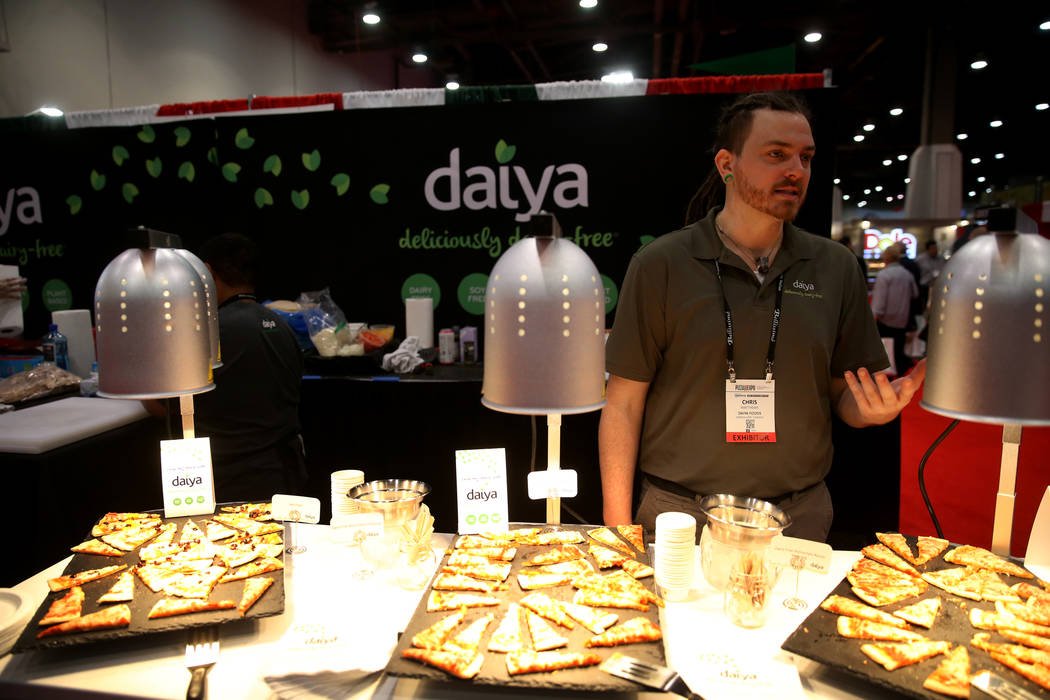 Chris Matthews of Daiya Foods of Canada talks to a reporter about his gluten-free and vegan pizza at the International Pizza Expo at the Las Vegas Convention Center Tuesday, March 5, 2019. (K.M. C ...
