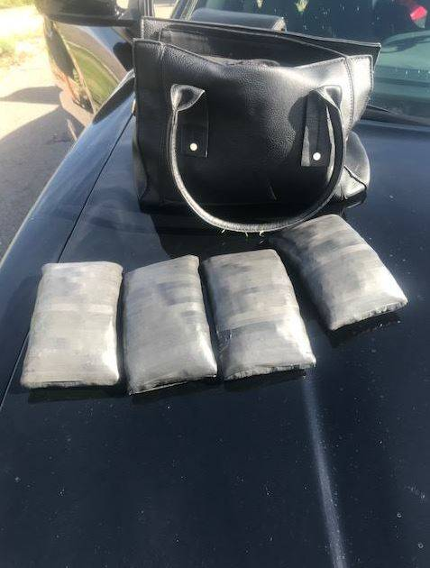 Four bundles of suspected fentanyl pills are shown Monday, March 4, 2019, during a traffic stop outside Eloy, Arizona. (Pinal County Sheriff's Office/Facebook)