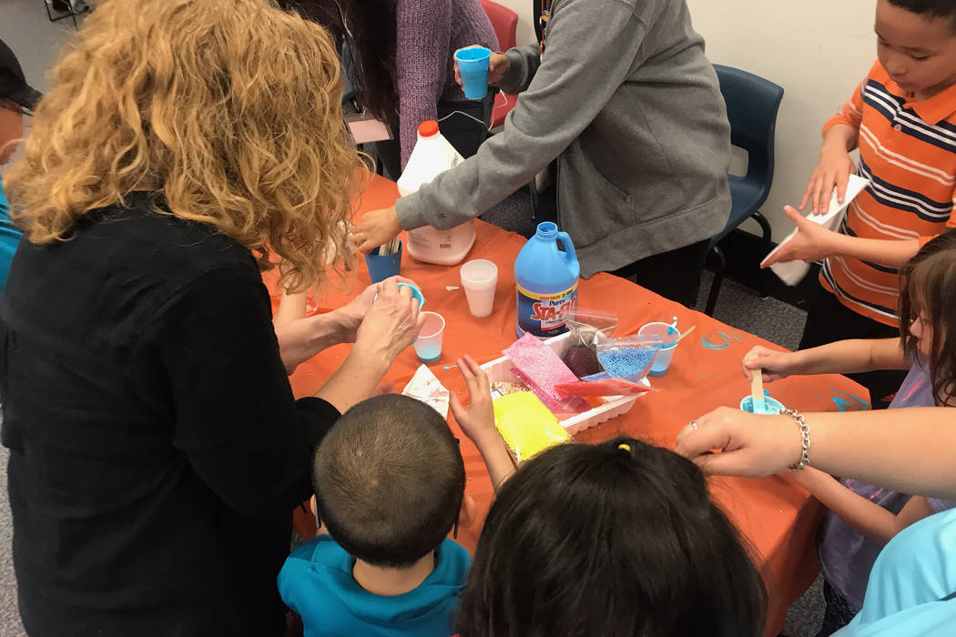 Attendees at the Gross World Records event help each other make slime after a presentation from Kathryn Tilton. (Mia Sims-Las Vegas Review-Journal/@miasims___)