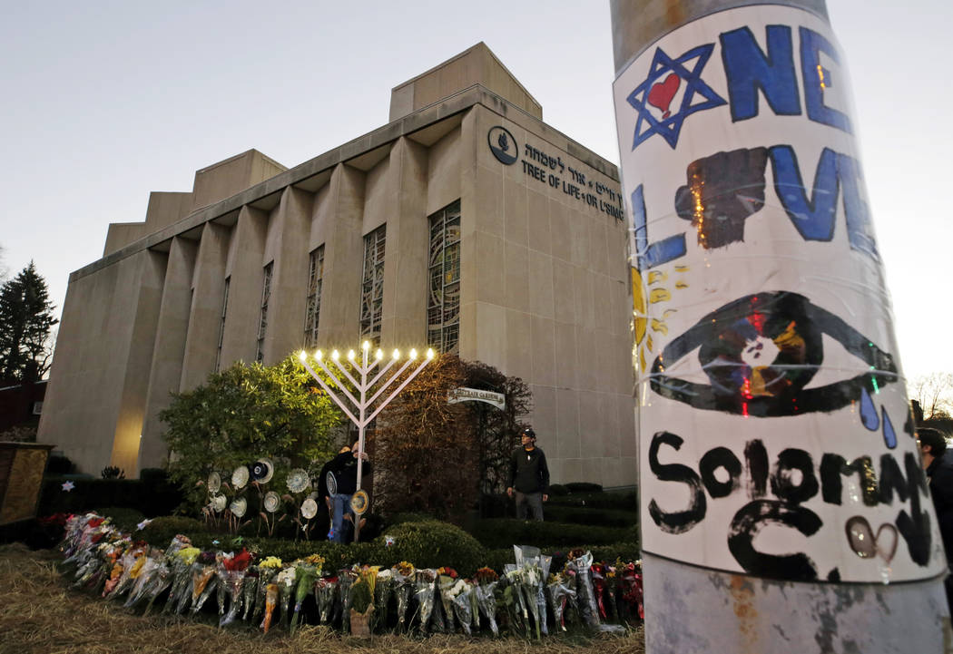 A menorah is tested outside the Tree of Life Synagogue in preparation for a celebration service at sundown on the first night of Hanukkah, in the Squirrel Hill neighborhood of Pittsburgh on Dec. 2 ...