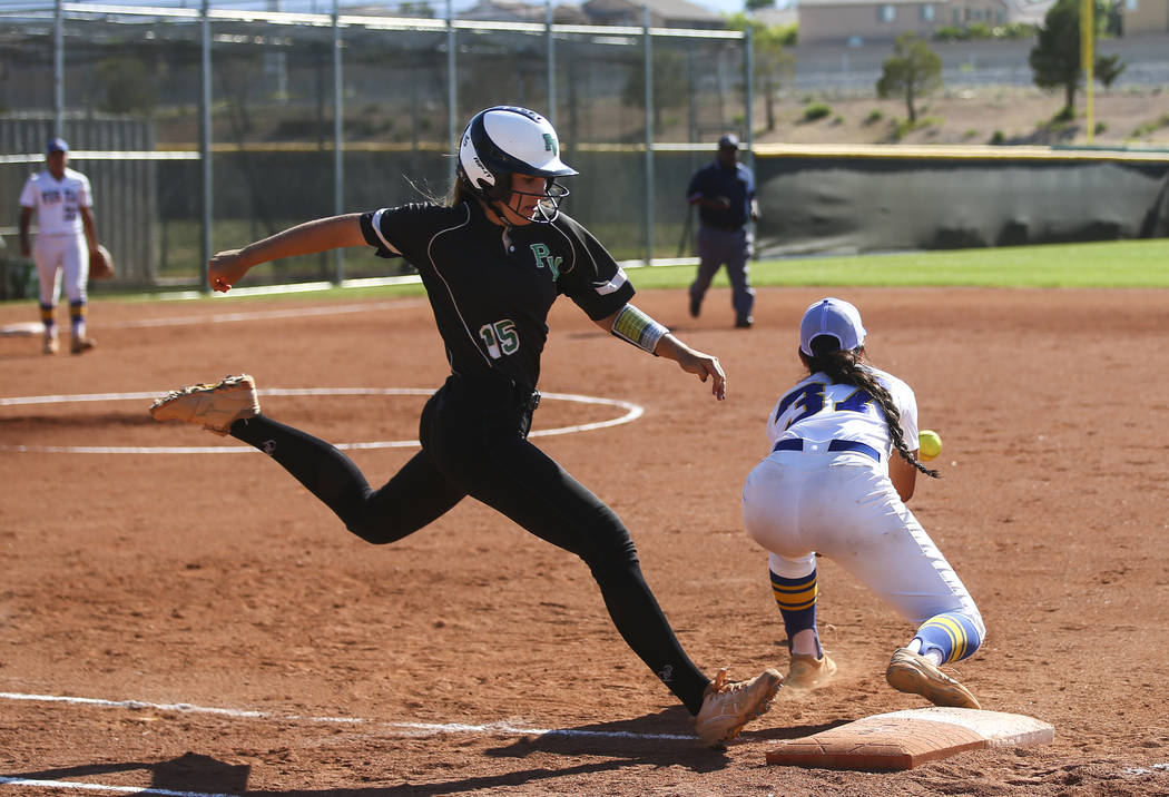 Palo Verde's Makena Martin (15) makes it to first base against Sierra Vista's Holarose Nakayama (37) during a Sunset Region softball tournament game at Palo Verde High School in Las Vegas on Thurs ...