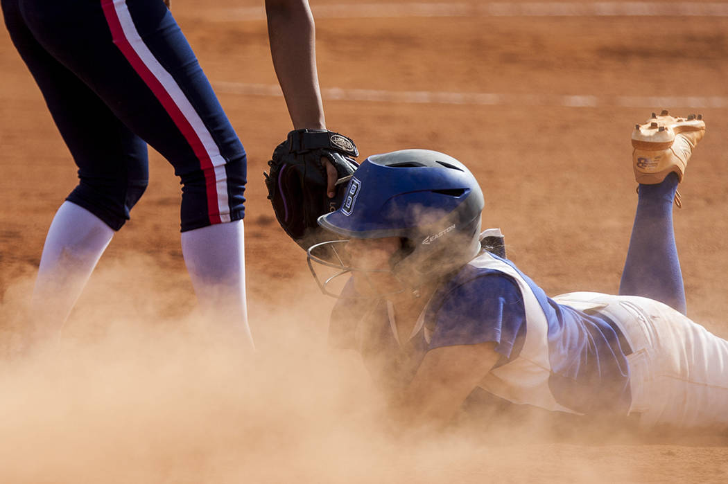 Basic's Mikayla Berg slides in safe at first during the fifth inning at Basic High School in Henderson on Wednesday, April 18, 2018. Basic won 11-2. Patrick Connolly Las Vegas Review-Journal @PCo ...
