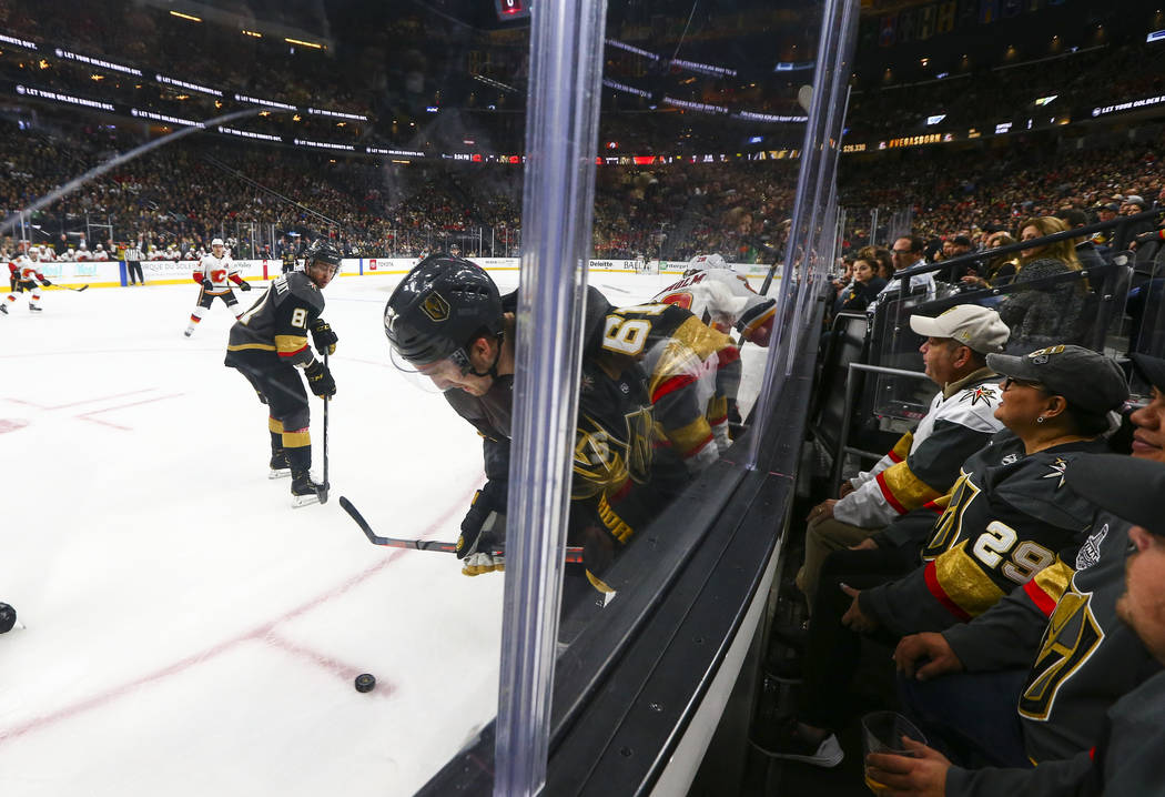 Golden Knights right wing Mark Stone (61) moves the puck against the Calgary Flames during the first period of an NHL hockey game at T-Mobile Arena in Las Vegas on Wednesday, March 6, 2019. (Chase ...