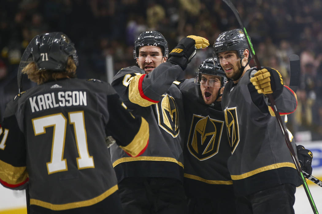 Golden Knights defenseman Shea Theodore, right, celebrates his goal with teammates, from left, center William Karlsson, right wing Mark Stone and center Jonathan Marchessault during the first peri ...