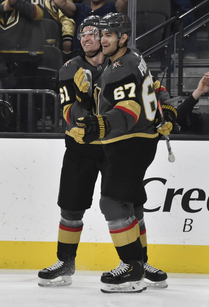Vegas Golden Knights right wing Mark Stone (61) and left wing Max Pacioretty (67) celebrate Pacioretty's goal against the Vancouver Canucks during the second period of an NHL hockey game Sunday, M ...