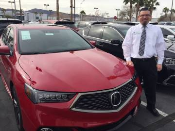 Findlay Acura sales manager Brian Castaneda stands alongside the 2019 Acura TLX A-Spec at the Valley Automall in Henderson. (Findlay)