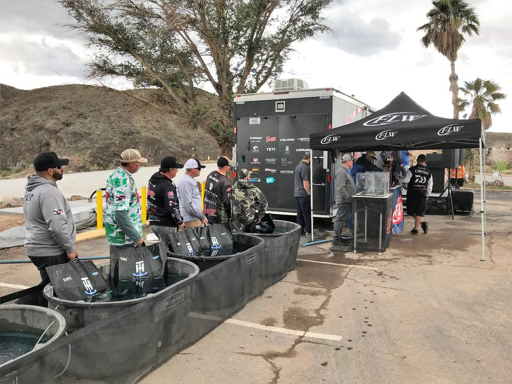 Professional anglers keep their catch in aerated tubs of water while awaiting their turn at the scales on Championship Saturday of the Costa FLW Series Western Division bass tournament at Callvill ...