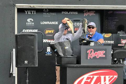 Tim Klinger, of Boulder City, holds up two of the five bass that brought his tournament total to 34-pounds, 12-ounces and gave him the victory on Championship Saturday of the Costa FLW Series West ...