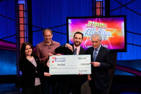 "This photo provided by Sony shows Brad Rutter, Larissa Kelly and David Madden with Alex Trebek, winners of the first ""Jeopardy!"" team championship, Tuesday, March 5, 2019 in in Burbank, Calif. (Ca ..."