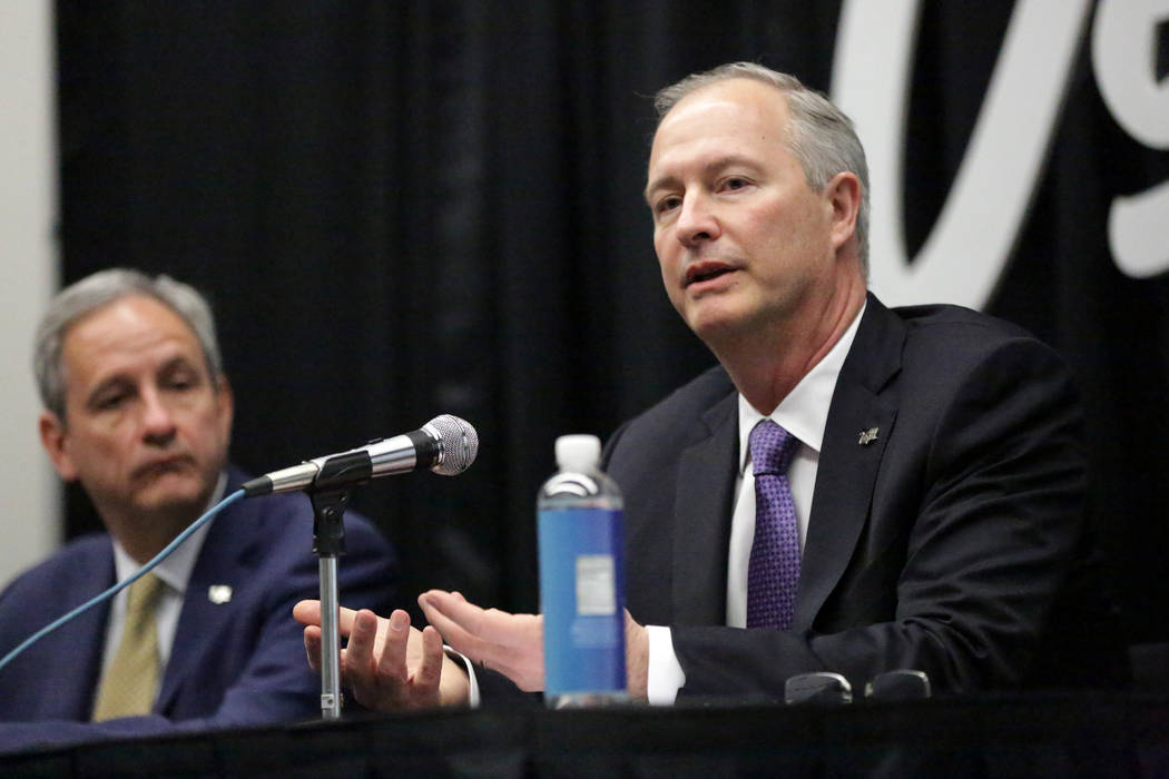 Brian Yost, Las Vegas Convention and Visitors Authority (LVCVA) chief operating officer, left, and Steve Hill, LVCVA president and CEO, address the media to announce the recommendation for an unde ...